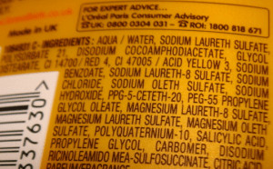Close up ingredients label of yellow bottle.
