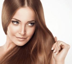 Woman with sleek light-brown hair.