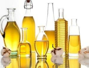 An array of oil in different glass bottles.