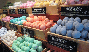 Bath bombs sorted by color.