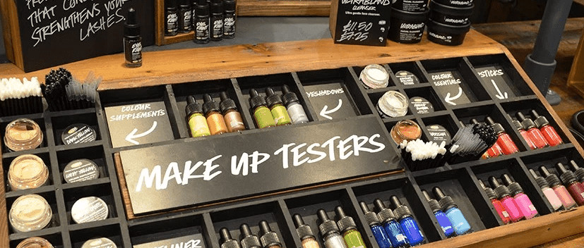 Display of Lush makeup testers.