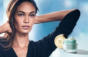 Woman with Estée Lauder product.