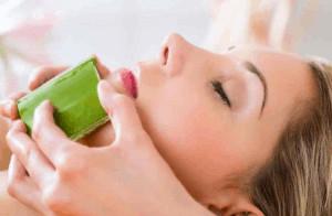 Woman getting an aloe vera facial treatment.