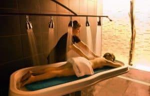Woman receiving vichy shower.
