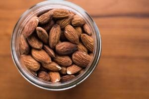 Birds eye view of almonds in jar.