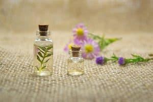 Jars and purple flowers on burlap