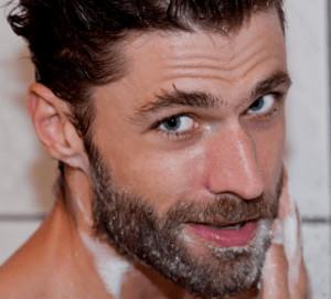 Man washing his beard.