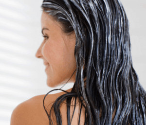 Woman with leave-in conditioner in her hair.