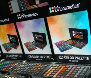 Assorted collection of colorful eyeshadow palettes.