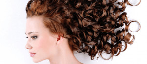 Woman with red, curly hair.