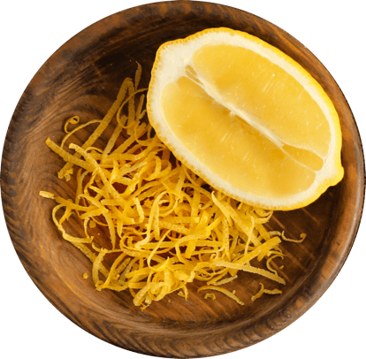 Lemon half and rind in a bowl.