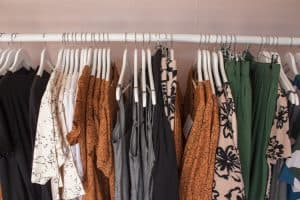 Clothes hanging in cupboard.