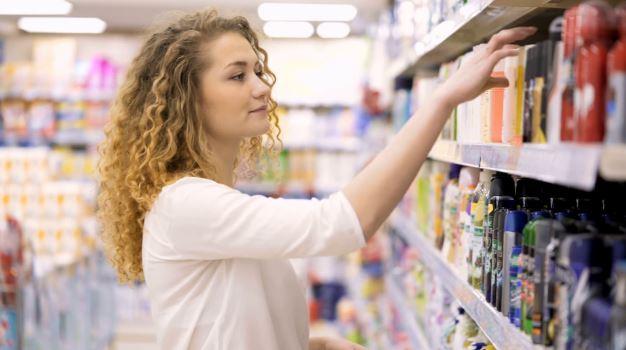 Woman browsing in supermarket.