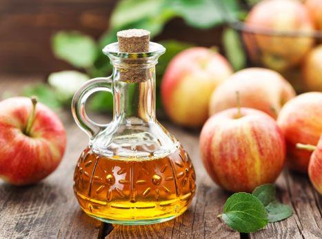 Apples and apple cider vinegar in a jar.