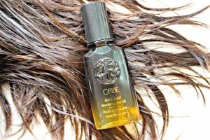Oribe Hair Oil on hair strands.