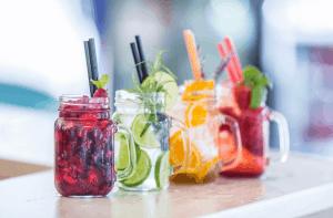 Four mason jars filled with fruit juice.