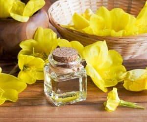 Evening primrose oil surrounded by evening primrose.