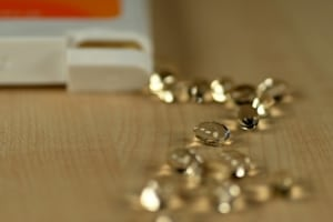 Supplement pills in pile on table.