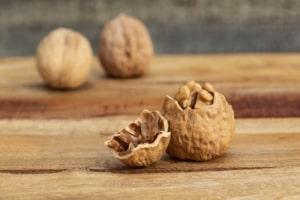 Cracked walnut on table.