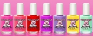 A variety of PiggyPolish nail polish.