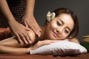 Woman receiving a Thai massage.