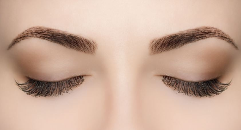 Close up of woman's eyes closed.